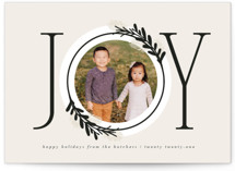 This is a beige christmas postcard by JeAnna Casper called Center Joy with standard printing on signature in postcard.