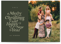 This is a green christmas postcard by Brianne Larsen called Merry and Happy with standard printing on signature in postcard.