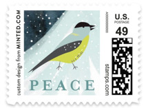 This is a blue christmas stamp by Eve Schultz called Snowfall with standard printing on adhesive postage paper in stamp.