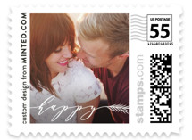 This is a white christmas stamp by Minted called HAPPY with standard printing on adhesive postage paper in stamp.