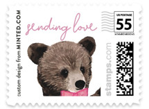 This is a pink christmas stamp by Cass Loh called Baby Bear with standard printing on adhesive postage paper in stamp.