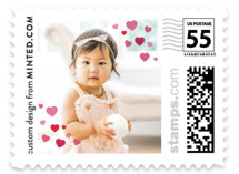 This is a pink christmas stamp by Minted called Heart Confetti with standard printing on adhesive postage paper in stamp.