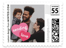 This is a pink christmas stamp by Minted called Heart Message with standard printing on adhesive postage paper in stamp.
