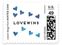 This is a blue christmas stamp by Ashlee Townsend called #LOVEWINS with standard printing on adhesive postage paper in stamp.