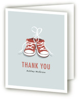 This is a red baby shower thank you card by Laura Condouris called Tiny Sneakers with standard printing on strathmore in standard.