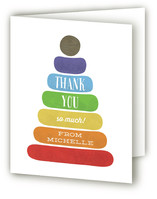 This is a colorful baby shower thank you card by Kate Sorensen called Classic Stacking Toy with standard printing on strathmore in standard.