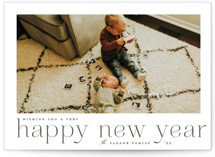 This is a green holiday photo card by Carolyn Nicks called large headline with standard printing on smooth signature in standard.