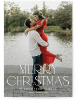 This is a white holiday photo card by Robert and Stella called Sutton with standard printing on signature in standard.