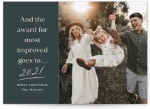 This is a green holiday photo card by Kaydi Bishop called Most Improved with standard printing on recycled smooth signature in standard.