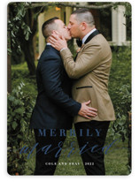 This is a blue holiday photo card by Roxy Cervantes called Merrily Married with standard printing on smooth signature in standard.