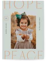This is a grey holiday photo card by Meg Gleason called hope + peace with standard printing on pearlescent in standard.