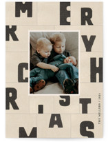 This is a beige holiday photo card by Sumak Studio called christmas typography with standard printing on doublethick in standard.