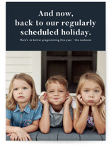 This is a blue holiday photo card by Jackie Crawford called Regularly Scheduled Program with standard printing on signature in standard.