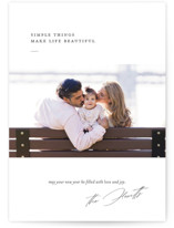 This is a white holiday photo card by Eric Clegg called life is beautiful with standard printing on smooth signature in standard.