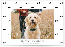 This is a black holiday photo card by Tamara Hilje called Bone tie with standard printing on signature in standard.