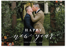 This is a white holiday photo card by Roxy Cervantes called Merrily Married with standard printing on smooth signature in standard.