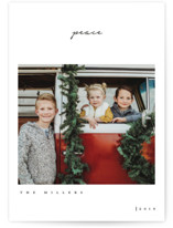 This is a white holiday photo card by Owl and Toad called One Word with standard printing on smooth signature in standard.