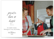 This is a white holiday photo card by Erika Firm called Peace Love and Cookies with standard printing on smooth signature in standard.