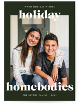 This is a green holiday photo card by Lindsay Stetson Thompson called holiday homebodies with standard printing on smooth signature in standard.