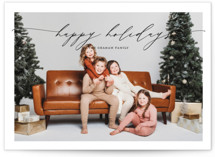 This is a black holiday photo card by Alexandra Cohn called Sweeping Script with standard printing on signature in standard.