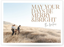 This is a brown holiday photo card by Eric Clegg called Bright Days with standard printing on smooth signature in standard.