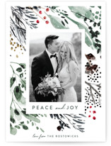 This is a green holiday photo card by Eve Schultz called Wonderland with standard printing on smooth signature in standard.