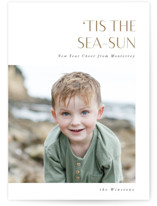 This is a brown holiday photo card by Bonjour Berry called Tis the Sea-Sun with standard printing on smooth signature in standard.