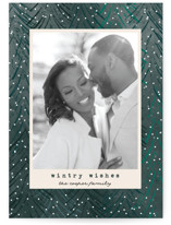 This is a green holiday photo card by Annie Holmquist called Wintry Wishes with standard printing on smooth signature in standard.