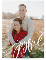 This is a white holiday photo card by Wildfield Paper Co. called Joyful pines with standard printing on smooth signature in standard.