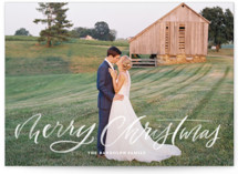 This is a white holiday photo card by Kristen Smith called Brushy Script with standard printing on smooth signature in standard.