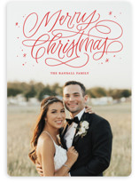 This is a red holiday photo card by Kristen Smith called Merry Shimmer with standard printing on smooth signature in standard.