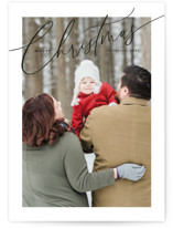 This is a black holiday photo card by Melanie Severin called Sloped Script with standard printing on smooth signature in standard.