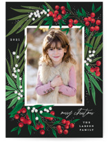 This is a black holiday photo card by Alethea and Ruth called Leafy Berries with standard printing on smooth signature in standard.