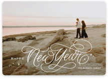 This is a white holiday photo card by Kristen Smith called Elegant Script with standard printing on smooth signature in standard.