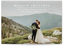 This is a white holiday photo card by Ashlee Townsend called First Married Christmas with standard printing on smooth signature in standard.