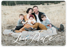 This is a white holiday photo card by Wildfield Paper Co. called Wishing Love + Peace with standard printing on smooth signature in standard.