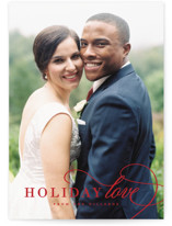 This is a red holiday photo card by Kimberly FitzSimons called Holiday Love From Us with standard printing on smooth signature in standard.