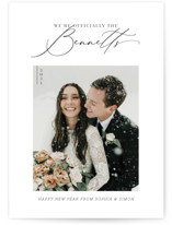 This is a black holiday photo card by Carolyn Kach called Officially Official with standard printing on smooth signature in standard.