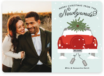 This is a red holiday photo card by Bonjour Berry called Newlywed Christmas with standard printing on smooth signature in standard.