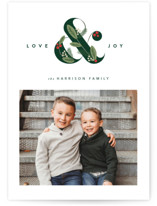 This is a green holiday photo card by Robert and Stella called Festive Ampersand with standard printing on smooth signature in standard.