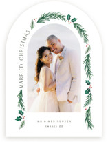 This is a white holiday photo card by Hooray Creative called a married christmas with standard printing on pearlescent in standard.