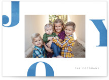 This is a blue holiday photo card by Jessica Maslyn called Letters of Joy with standard printing on smooth signature in standard.