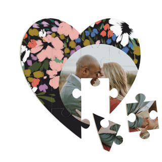 This is a black heart puzzle by Angela Marzuki called spring dream printing on signature in 12 piece.
