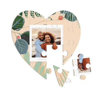 This is a beige heart puzzle by Baumbirdy called Bold Floral printing on signature in 12 piece.