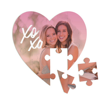 This is a orange heart puzzle by Jessie Steury called Candy Colored printing on signature in 12 piece.