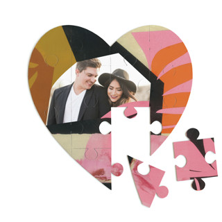 This is a pink heart puzzle by cyrille gulassa called Blaze printing on signature in 12 piece.