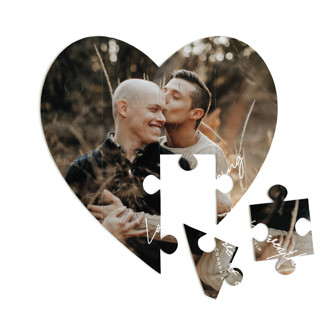 This is a white heart puzzle by Design Lotus called Everything printing on signature in 12 piece.