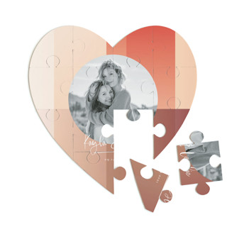 This is a orange heart puzzle by Baumbirdy called Gradient Background printing on signature in 12 piece.