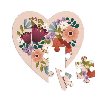 This is a pink heart puzzle by Lauren Brown called Floral Heart printing on signature in 12 piece.