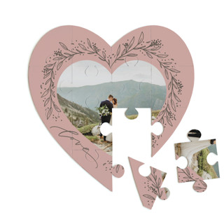 This is a pink heart puzzle by Erin German called Botanical Heart printing on signature in 12 piece.